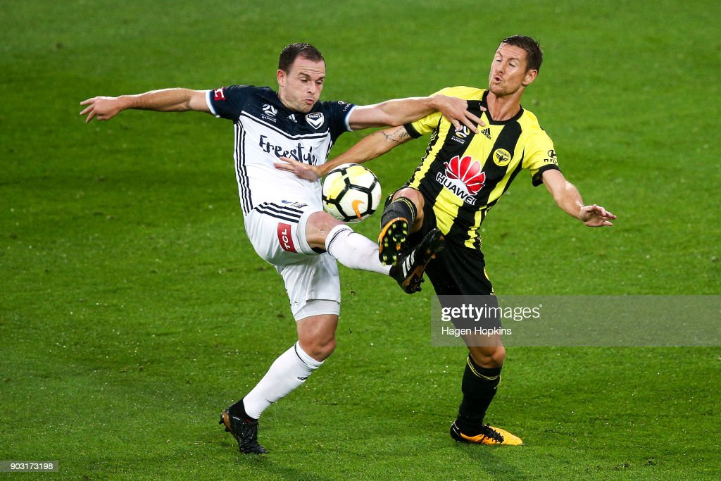 Leigh Broxham of the Victory and Nathan Burns of the Phoenix compete for the ball during the round 15 A-League match between the Wellington Phoenix and Melbourne Victory at Westpac Stadium on January 10, 2018 in Wellington, New Zealand.