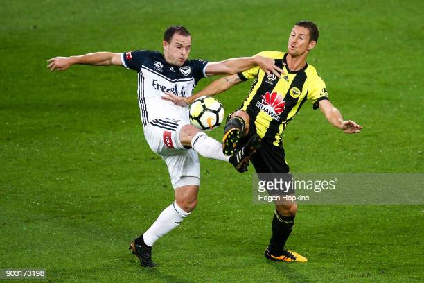Leigh Broxham of the Victory and Nathan Burns of the Phoenix compete for the ball during the round 15 ALeague match between the Wellington Phoenix...