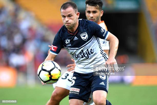 Leigh Broxham of the Victory breaks away from the defence during the round 11 ALeague match between the Brisbane Roar and the Melbourne Victory at...