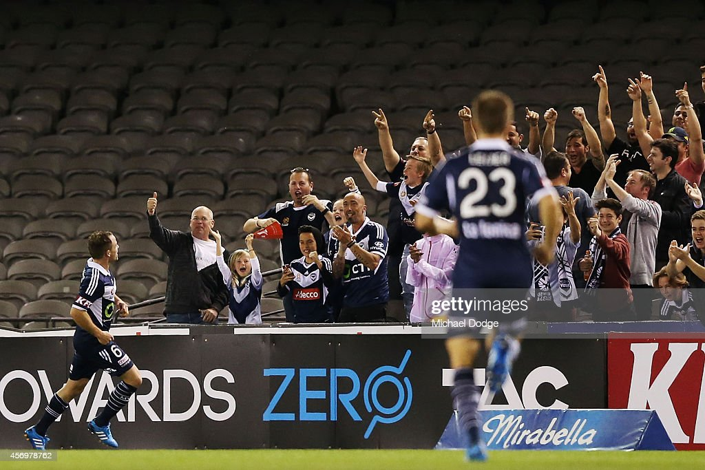 Leigh Broxham of the Victory celebrates a goal during the round one A-League match between Melbourne Victory and the Western Sydney Wanderers at Etihad Stadium on October 10, 2014 in Melbourne, Australia.
