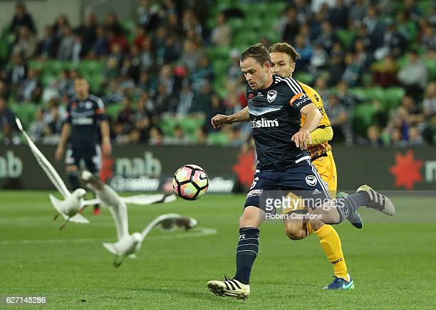Leigh Broxham of the Victory chases the ball during the round nine ALeague match between Melbourne Victory and Perth Glory at AAMI Park on December 2...