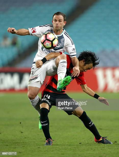 Leigh Broxham of the Victory competes for the ball against Jumpei Kusukami of the Wanderers during the round 26 ALeague match between the Western...