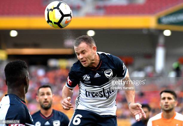 Leigh Broxham of the Victory heads the ball during the round 11 ALeague match between the Brisbane Roar and the Melbourne Victory at Suncorp Stadium...