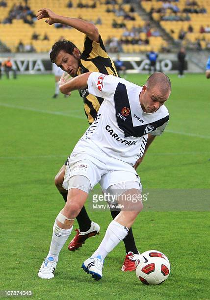 Leigh Broxham of the Victory holds off Vince Lia of the Phoenix during the round 21 ALeague match between the Wellington Phoenix and the Melbourne...