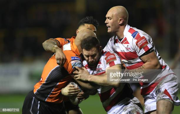 Leigh Centurions' Mitch Brown is tackled by Castleford Tigers' Ben Crooks during the Super League match at the MendAHose Jungle Castleford