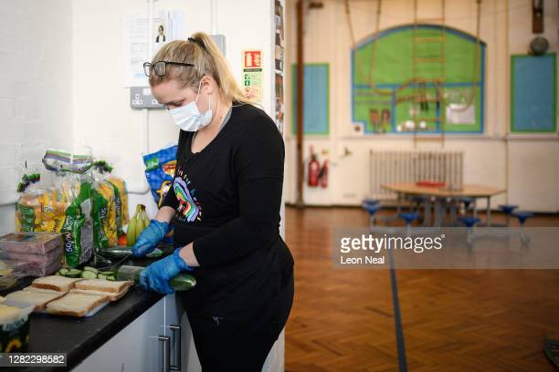 Leigh Ellwood owner of Planet Youth holiday and afterschool camps prepares food lunch packs for those who are in need of free children's meals over...
