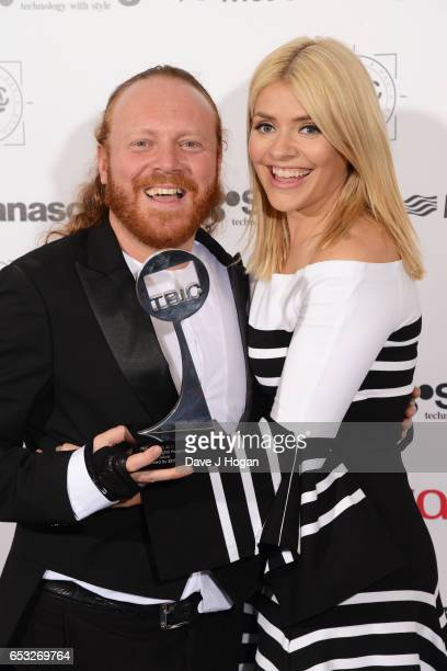 Leigh Francis and Holly Willoughby pose in the winners room with the award for Satellite/Digital Programme at the TRIC Awards 2017 at The Grosvenor...