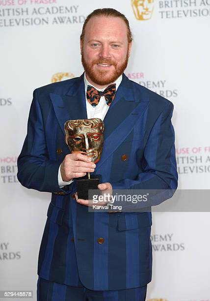 Leigh Francis winner of the Entertainment Performance award for 'Celebrity Juice' poses in the winners room at the House Of Fraser British Academy...