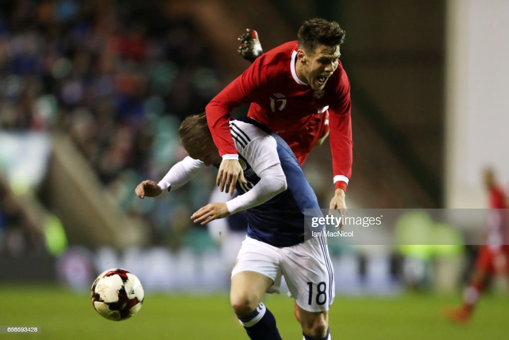 Leigh Griffith of Scotland vies with Maxim Tissot of Canada during the International Challenge Match between Scotland and Canada at Easter Road on March 22, 2017 in Edinburgh, Scotland.