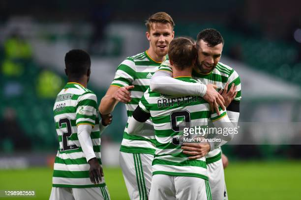 Leigh Griffiths of Celtic celebrates after scoring their sides first goal with team mates during the Ladbrokes Scottish Premiership match between...