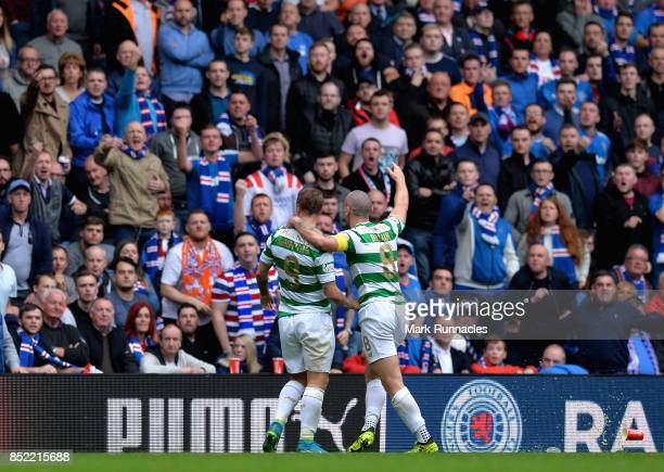 Leigh Griffiths of Celtic celebrates scoring his sides second goal with Scott Brown of Celtic during the Ladbrokes Scottish Premiership match between...