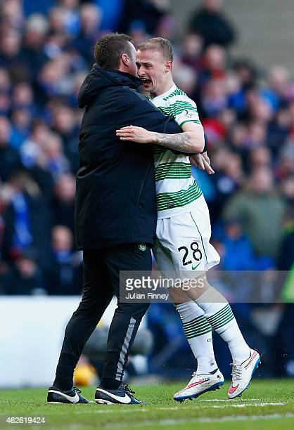 Leigh Griffiths of Celtic celebrates scoring the opening goal with Manager Ronny Deila of Celtic during the Scottish League Cup Semi-Final between...