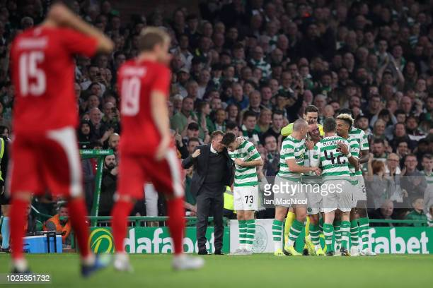 Leigh Griffiths of Celtic celebrates with his team after scoring his 100th goal for the club during the second leg of the UEFA Europa League Play Off...