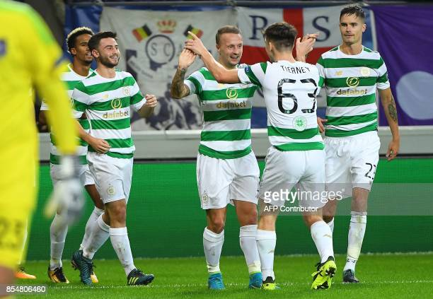 Leigh Griffiths of Celtic FC celebrates with teammates Kieran Tierney Mikael Lustig and others after scoring during the UEFA Champions League Group B...