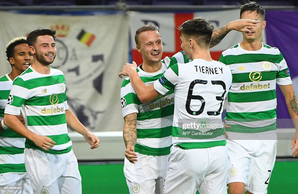 Leigh Griffiths of Celtic FC (C) celebrates with teammates Kieran Tierney (2R), Mikael Lustig (R) and others after scoring during the UEFA Champions League Group B football match Anderlecht vs Celtic at The Constant Vanden Stock Stadium in Brussels on September 27, 2017. /