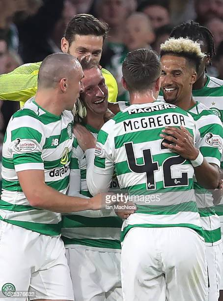 Leigh Griffiths of Celtic is congratulated after scoring his sides opening goal during the UEFA Europa League Play Off Second Leg match between...