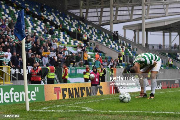Leigh Griffiths of Celtic picks up some of the objects thrown at him by Linfield fans during the Champions League second round first leg qualifying...