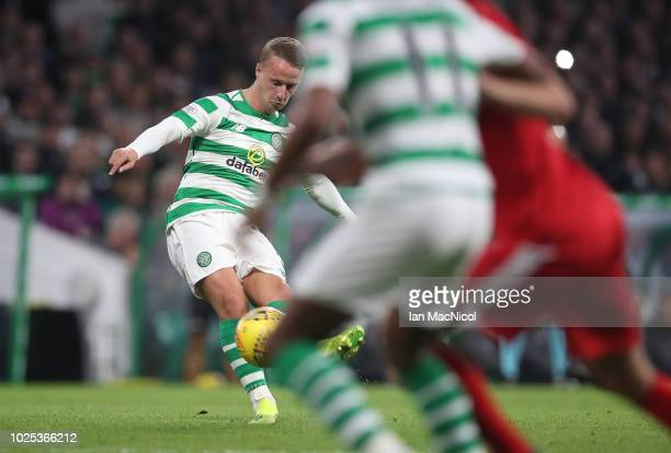 Leigh Griffiths of Celtic scores his team's opening goal during the UEFA Europa League Play Off Second Leg match between Celtic and FK Suduva at...