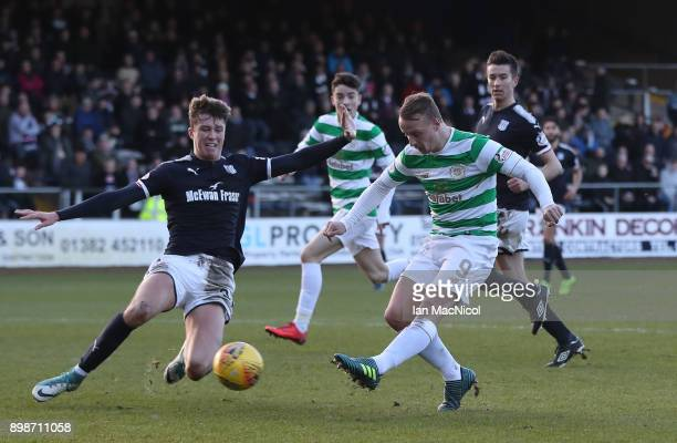 Leigh Griffiths of Celtic scores his team's second goal during the Scottish Premier League match between Dundee and Celtic at Dens Park on December...