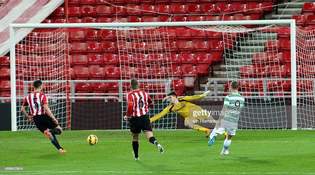 Leigh Griffiths of Celtic (R) scores the first Celtuc goal during The Premier League International Cup match between Sunderland U21 v Celtic U21 at the Stadium of Light on December 18, 2014 in Sunderland, England.