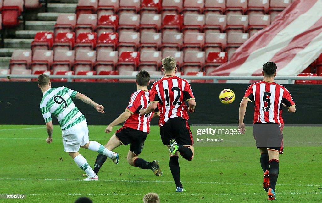 Leigh Griffiths of Celtic (L) scores the second Celtic goal during The Premier League International Cup match between Sunderland U21 v Celtic U21 at the Stadium of Light on December 18, 2014 in Sunderland, England.