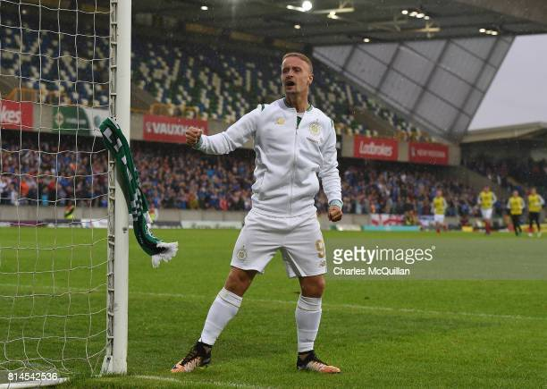 Leigh Griffiths of Celtic ties a Celtic scarf onto a goalpost which sparked crowd disorder after the Champions League second round first leg...