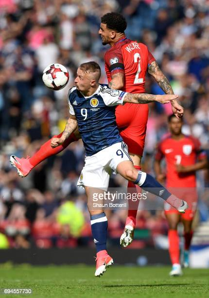 Leigh Griffiths of Scotland and Kyle Walker of England battle to win a header during the FIFA 2018 World Cup Qualifier between Scotland and England...