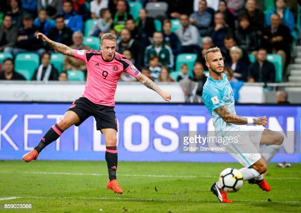 Leigh Griffiths of Scotland scores the opening goal near Aljaz Struna of Slovenia during the FIFA 2018 World Cup Qualifier match between Slovenia and...