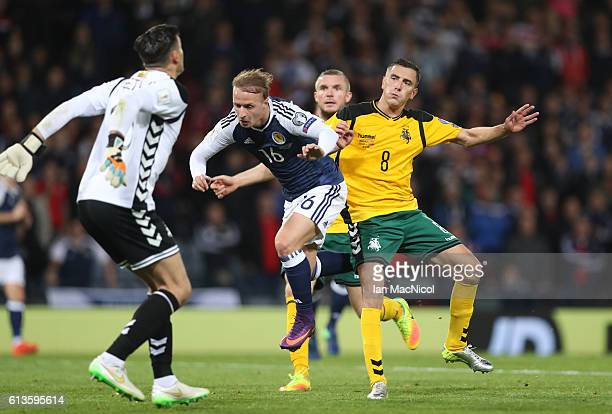 Leigh Griffiths of Scotland vies with Georgas Freidgeimas of Lithuania during the FIFA 2018 World Cup Qualifier between Scotland and Lithuania at...