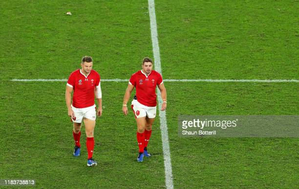 Leigh Halfpenny and Dan Biggar of Wales react as they walk off the pitch following the Rugby World Cup 2019 SemiFinal match between Wales and South...