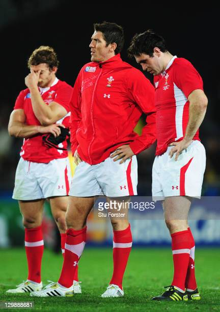 Leigh Halfpenny, James Hook and Stephen Jones of Wales show their dejection after the 2011 IRB Rugby World Cup bronze final match between Wales and...