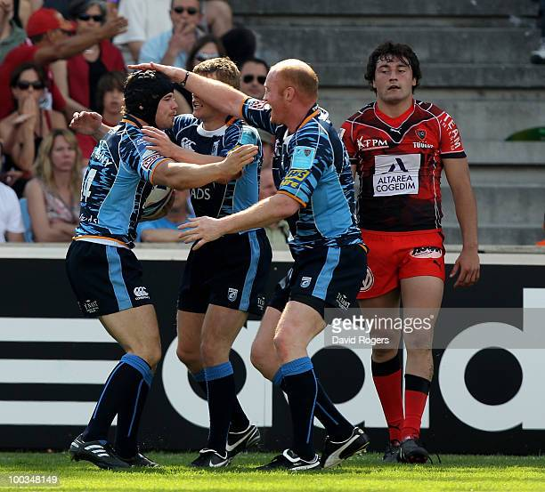 Leigh Halfpenny of Cardiff is congratulated by team mates after scoring a try during the Amlin Challenge Cup Final between Toulon and Cardiff Blues...