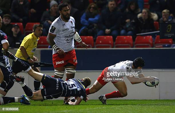 Leigh Halfpenny of RC Toulon dives over the line to score the second try during the European Rugby Champions Cup match between Sale Sharks and RC...