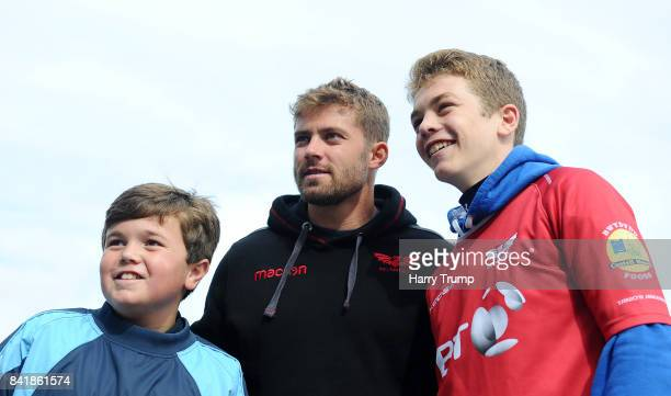 Leigh Halfpenny of Scarlets poses for a photo with fans during the Guinness Pro14 match between Scarlets and Southern Kings at Parc y Scarlets on...