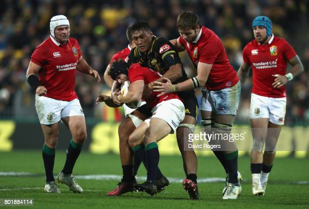 Leigh Halfpenny of the Lions is tackled during the match between the Hurricanes and the British Irish Lions at Westpac Stadium on June 27 2017 in...