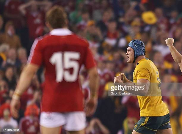 Leigh Halfpenny of the Lions looks on after attempting to kick a penalty in the final minute as James Horwill of the Wallabies celebrates victory...