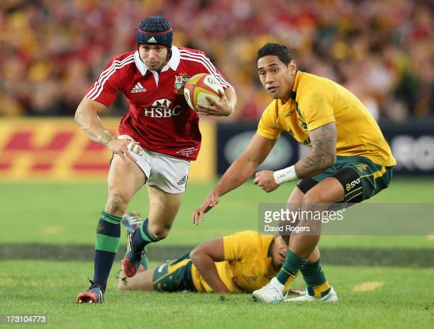 Leigh Halfpenny of the Lions races away from Joe Tomane during the International Test match between the Australian Wallabies and British Irish Lions...