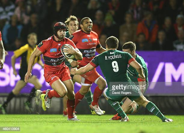 Leigh Halfpenny of Toulon takes on Ben Youngs during the European Rugby Champions Cup pool three match between RC Toulon and Leicester Tigers at...