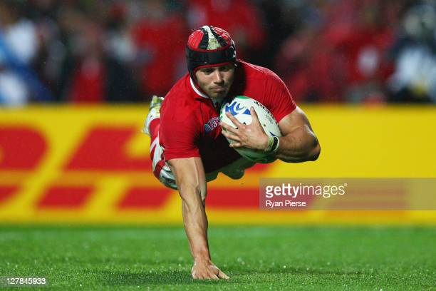 Leigh Halfpenny of Wales goes over to score their sixth try during the IRB Rugby World Cup Pool D match between Wales and Fiji at Waikato Stadium on...