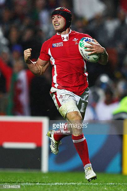 Leigh Halfpenny of Wales goes through to score their sixth try during the IRB Rugby World Cup Pool D match between Wales and Fiji at Waikato Stadium...