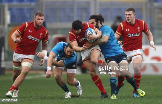Leigh Halfpenny of Wales is tackled by Luke McLean of Italy during the RBS Six Nations match between Italy and Wales at the Stadio Olimpico on...