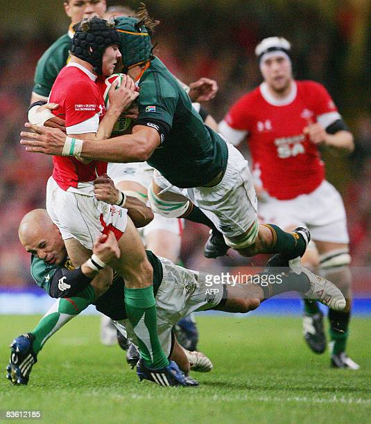 Leigh Halfpenny of Wales is tackled by South Africa's Conrad Jantes and Victor Matfies during their Invesco Perpetual Series Rugby Union internatonal...