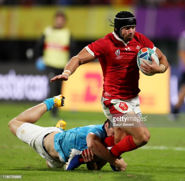Leigh Halfpenny of Wales is tackled by Tomas Inciarte of Uruguay during the Rugby World Cup 2019 Group D game between Wales and Uruguay at Kumamoto...