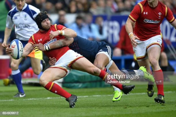 Leigh Halfpenny of Wales is tackled during the RBS Six Nations match between France and Wales at Stade de France on March 18 2017 in Paris France