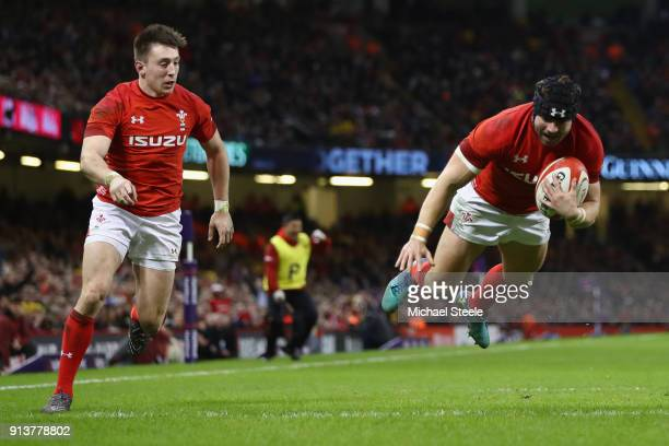 Leigh Halfpenny of Wales supported by Josh Adams dives over to score his second try during the NatWest Six Natons match between Wales and Scotland at...