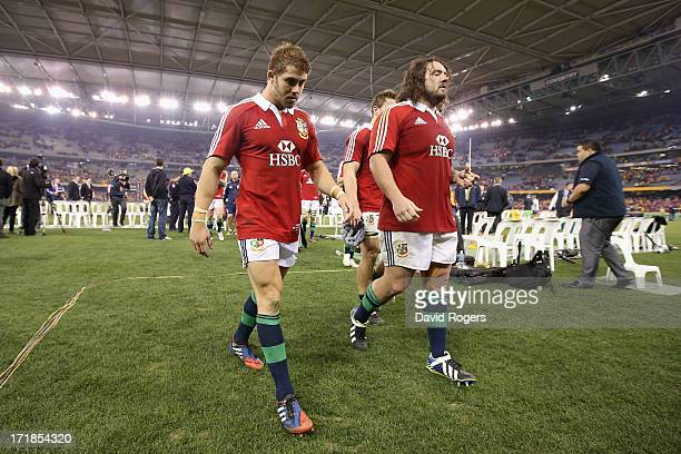 Leigh Halfpenny the Lions fullback who had a chance to win the match with a last minute penalty walks off the field with team mate Adam Jones after...