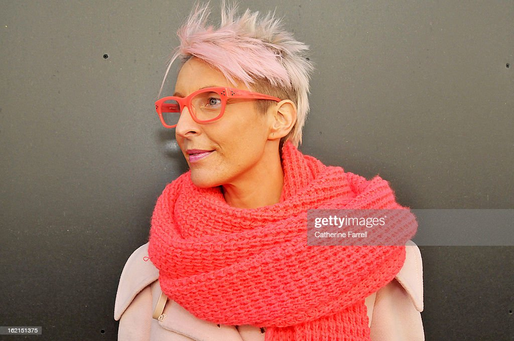 Leigh Hawkes, Fashion Forecaster for Sportsgirl Melbourne, wearing a vintage coat and Sportsgirl scarf with Matthew Williams sunglasses at London Fashion Week Fall/Winter 2013/14 on February 19, 2013 in London, England.