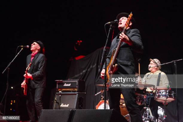Leigh Heggarty John 'Segs' Jennings and David Ruffy of Ruts DC perform at Brixton Academy on March 24 2017 in London United Kingdom