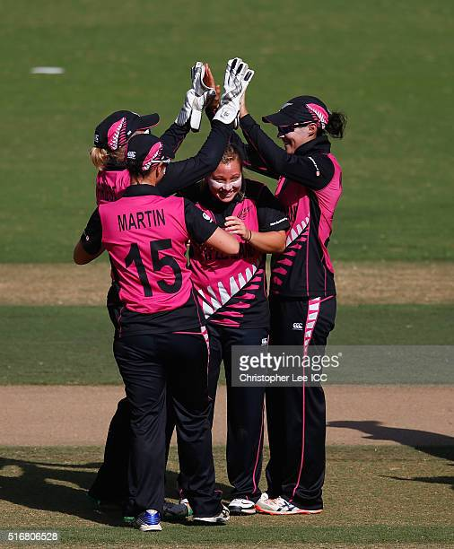 Leigh Kasperek of New Zealand is congratulated after she takes the wicket of Erin Osbourne of Australia during the Women's ICC World Twenty20 India...