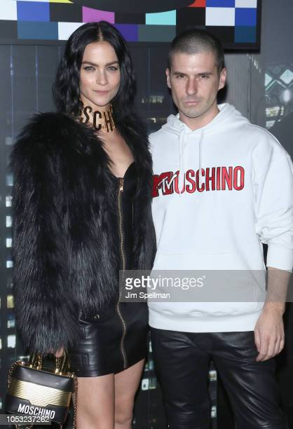Leigh Lezark and guest attend the Moschino x HM show at Pier 36 on October 24 2018 in New York City